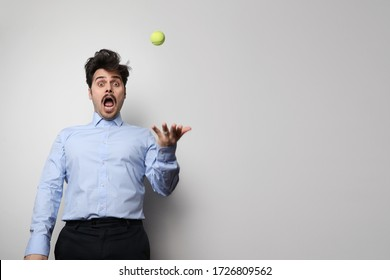 Dark hair bearded hipster with tennis ball. Businessman well groomed enjoy free time over white background. Isolated.