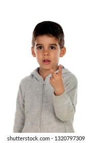 Dark haired child showing two fingers isolated on a white background