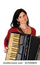 Dark haired woman with accordion in front of a white background