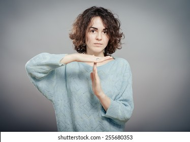 Dark haired woman making STOP gesture with hands, concept