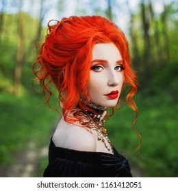 Dark halloween attire. Gothic woman is vampire with pale skin and red hair in a black dress and necklace on neck. Girl witch with red lips. Gothic attire. Witch outfit for halloween. Clean skin