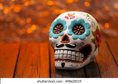Dark Halloween Dia De Los Muertos Celebration Background With Sugar Skull. Close Up Selective Focus With Copy Space.