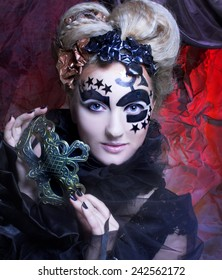 Dark Halloween  Lady. Portrait of young woman posing with mask