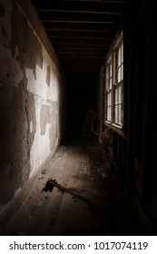 Dark hallway in an abandoned building. Natural light. Dark areas.