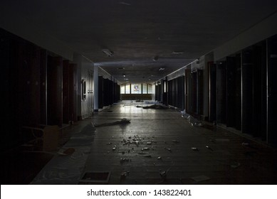 dark hallway with lockers inside an abandoned school.