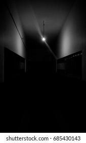 Dark hallway with a single light