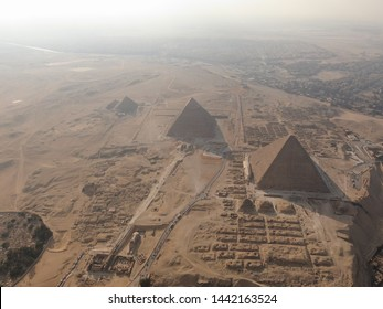 Dark, hazy Giza Pyramids and the Sphinx, aerial view