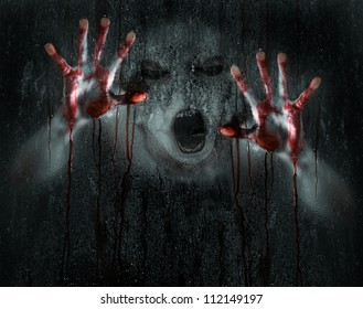 Dark Horror Scene of a Deformed Demon or Zombie with Bloody Hands against Wet Glass