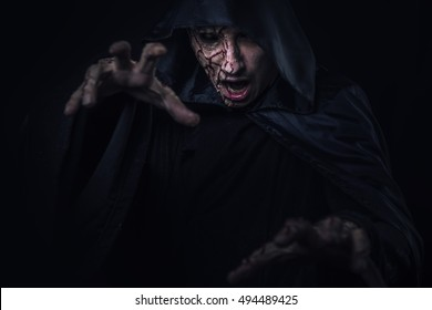 Dark horror warlock, scary male witch possessed by evil spirits