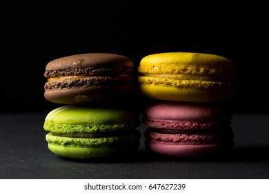 Dark image of fresh colorful macaroons