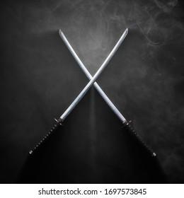 Dark image - Two katanas with crossed blades in dramatic smoke