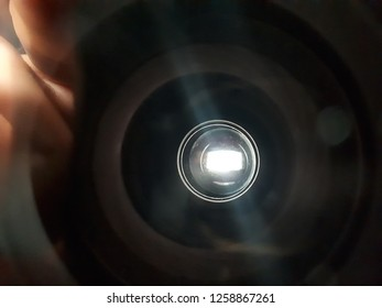 A dark tunnel? Or the inside of an old camera lens?