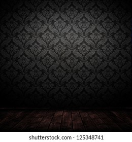 dark interior room with baroque wallpaper.