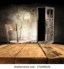 dark interior and shabby wall with open door