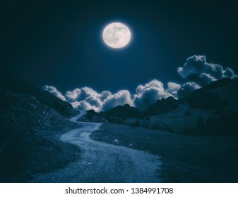 dark landscape with full moon and a path