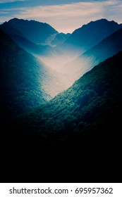 Dark landscape with mountains at sunset over Pyrenees. Perfect background for iphone, smartphone or tablet