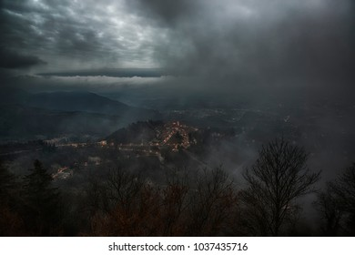 Dark landscape over the ancient little village of Sacred Mount of Varese in cloudy afternoon
