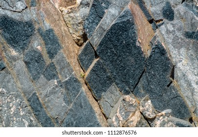 A dark and light natual checkerboard pattern on a rhyolite stone outcropping in Gold Butte National Monument, Clark County, Nevada, USA