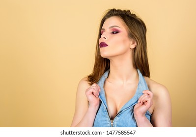 Dark lips and smoky eyes. Perfect makeup. Confident in her impeccable appearance. Makeup cosmetics concept. Feminine and glamorous. Attractive woman makeup face. Sensual fashion model sexy decollete.