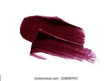 Dark lipstick smear smudge swatch. Plum color cosmetic product brush stroke isolated on white background. Makeup texture