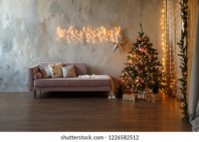 Dark loft living room decorated for Christmas with tree and lights