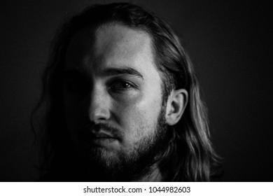 Dark, low key photography, male portrait