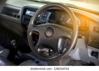 Dark luxury car Interior , steering wheel, shift lever and dashboard. Car interior luxury on blur background.