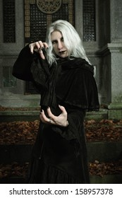 Dark mage is casting a spell . Halloween and horror