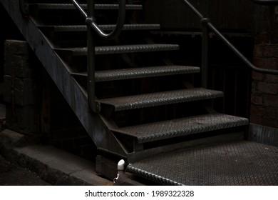 Dark masculine urban image of strong hard steel industrial steps, in Melbourne, Australia. - Shutterstock ID 1989322328
