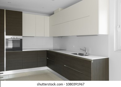 Dark minimal kitchen in a modern apartment. Nobody inside