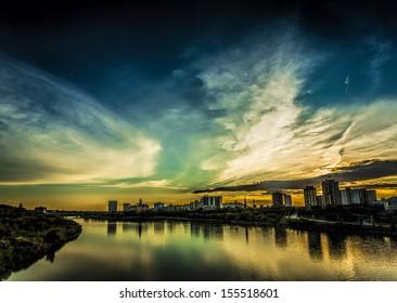 The dark and moody city skyline of Saskatoon, Canada at sunset.