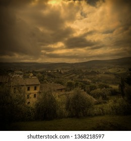 A dark and moody image of Tuscany, Italy at dusk