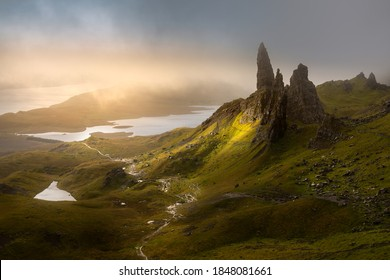 Dark and moody low clouds over the iconic Old Man of Storr on the Isle of Skye, Scotland, UK.
