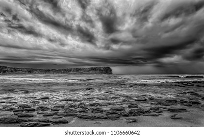 Dark and Moody Seascape - Capturing the sunrise from MacMasters Beach on the Central Coast, NSW, Australia.