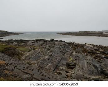 Dark moody seascape in Sligo, Ireland. Rainy day landscape with cinematic tones.