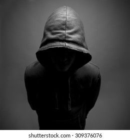 Dark and moody shot of youth wearing a hoody