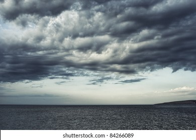 Dark moody sky over the gray sea.