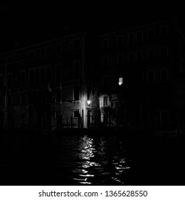 Dark and Moody Venice Italy Door at night across for canal