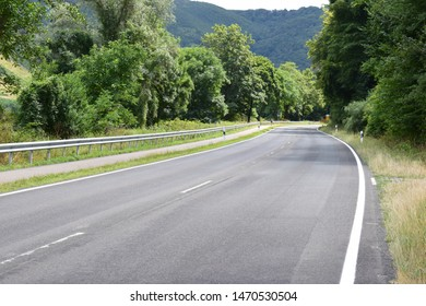 dark Moselle valley road curve