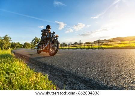 Dark motorbiker riding high