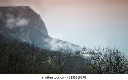 Dark mountain landscape with the Church of Christ's Resurrection. It is a popular tourist attraction on the outskirts of Yalta in the Crimea