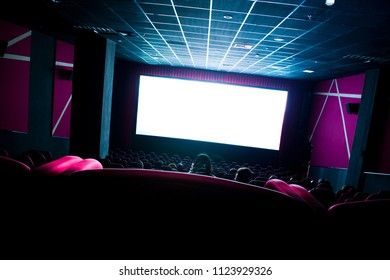 Dark movie theatre interior. tilted screen, chairs