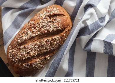 Dark multigrain bread fresh baked rustic breakfast food Whole grain homemade bakery tasty flat lay