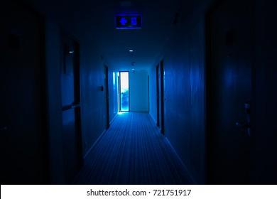 dark mysterious corridor in building, doors, perspective, in Dark Blue tones.Thriller  or Horror Concept.