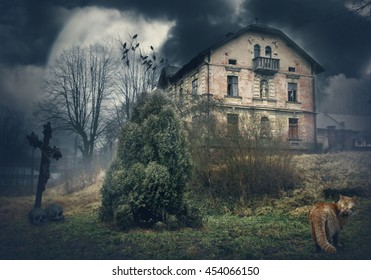 Dark mysterious Halloween landscape with old abandoned house