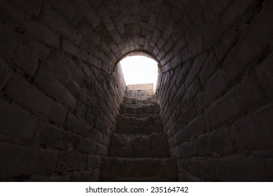 dark and narrow stone tunnel