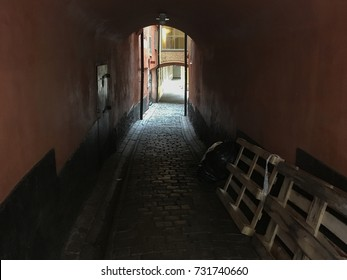 The dark narrow street leads to the light