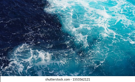 dark ocean water. drawing of sea water, the natural composition of ripples on the water. texture of foam in the water. wave splashing