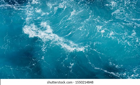 dark ocean water. sea water pattern, natural composition of ripples on the water. texture of foam in water