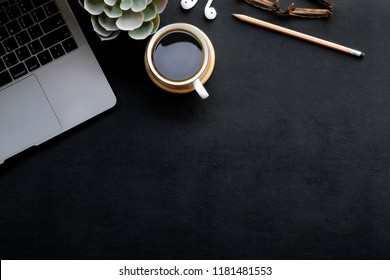 Dark office leather workspace desk and supplies. Workplace and copy space